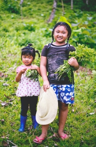 Balinese kids foraging wild fern tips for their family's dinner