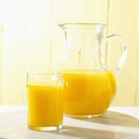 Glass and Pitcher of Orange Juice bxp159816h