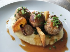 Coconut 'Meet Balls' with taro mash and rosemary jus